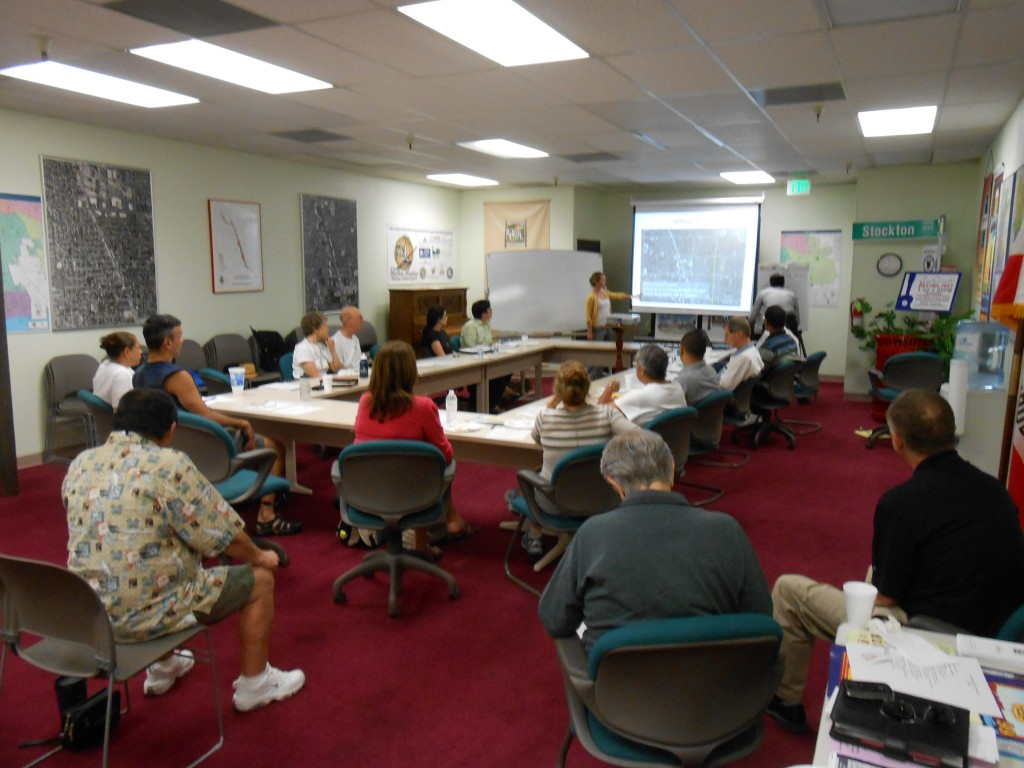 Community members review results of pedestrian and bicycle counts at and near Fruitridge / Stockton in July 2012