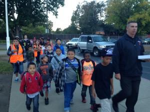 Principal Tom Lindeman leads a walking school bus at Thomas Edison Language Institute.