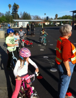 Students participating in bike safety drills led by Arlete Hodel